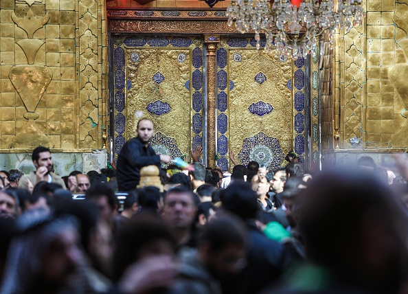 KARBALA, IRAQ - DECEMBER 03: Shi'ite Muslims pray and worship at the Imam Abbas Shrine during the Arbaeen ceremony in the Iraqi city of Karbala on December 03, 2015. Hundreds of worshippers attend the Arbaeen ceremony to mark the 40th day anniversary of Ashura, commemorating the martyrdom of Imam Hussein, grandson of Prophet Mohammad, in the holy city of Karbala. (Photo by Ayman Ali/Anadolu Agency/Getty Images)