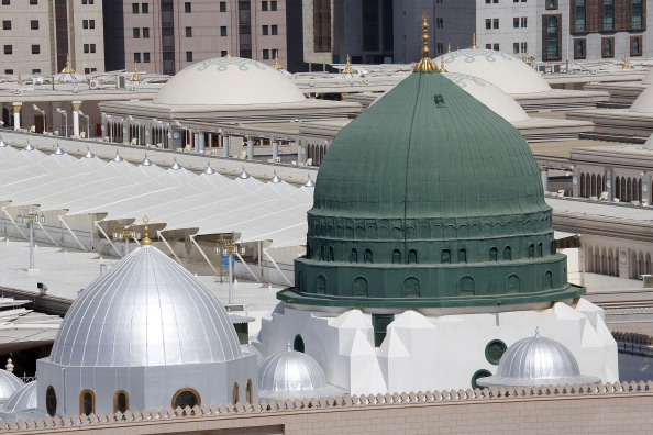MADINA, SAUDI ARABIA - OCTOBER 19: A view of the Masjid al-Nabawi (The Prophet's Mosque) on October 19, 2013 in Madina, Saudi Arabia. The muslim pilgrims who started their holy Hajj journey from Mecca start to come to al-Madinah al-Munawwarah kwnon as The City of the Prophet. Madina is one of the holiest city in Islam and it is the burial place of Prophet Muhammad. Thousands of pilgrims flooded to Mecca and Madina to perform their pilgrimage. The Hajj is an Islamic pilgrimage and the largest gathering of Muslim people in the world every year. (Photo by Cem Oksuz/Anadolu Agency/Getty Images)