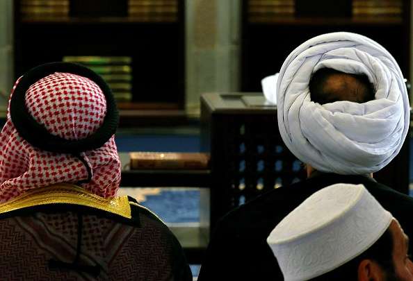 Kuwaiti Sunni and Shiite worshipers perform Friday prayers together in an act of solidarity at Kuwait's Sunni  Grand Mosque in Kuwait City on July 3, 2015. Kuwait's ministry of Awqaf and Islamic affairs called on Kuwaitis of all sects to perform the Friday prayer together as a show of national unity following a suicide bombing at a Shiite Mosque the previous week. AFP PHOTO / YASSER AL-ZAYYAT        (Photo credit should read YASSER AL-ZAYYAT/AFP/Getty Images)