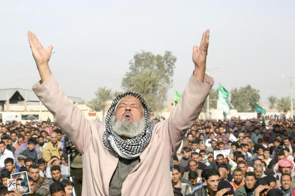 BAGHDAD, IRAQ:  An Iraqi Shiite Muslim man praises God during Friday midday prayers at the al-Mohsen mosque in Baghdad's predominantly Shiite Sadr City neighborhood 09 January 2004. In his impassioned and fiercely nationalist sermon, Imam Abdul Hadi al-Daraji claimed that the Iraqi flag had not been displayed at recent graduation ceremonies for the 2nd Battalion of the new Iraqi army and lashed out at the US and Jews.     AFP PHOTO/Hani AL-OBEIDI  (Photo credit should read HANI AL-OBEIDI/AFP/Getty Images)