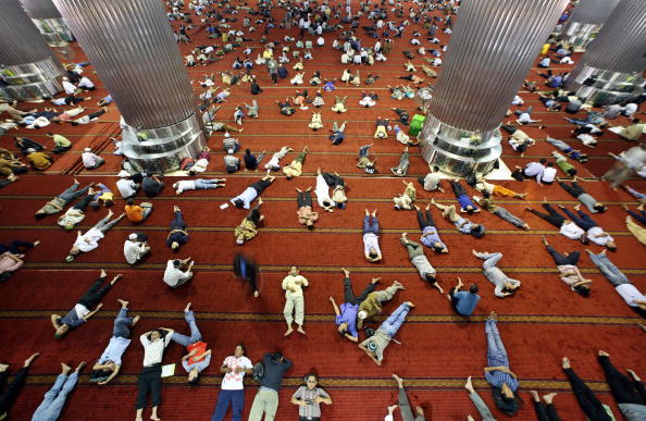 Indonesian muslims take a nap at a mosque after the Friday noon prayer in Jakarta, 14 September 2007, as devotees observe their holy fasting month of Ramadan. Practicing Muslims desist eating, drinking, smoking and any sexual activities from dawn to dusk during Ramadan. More than 90 percent of Indonesia's some 220 million people follow Islam, making it the worlds biggest Muslim nation. AFP PHOTO/Ahmad ZAMRONI (Photo credit should read AHMAD ZAMRONI/AFP/Getty Images)