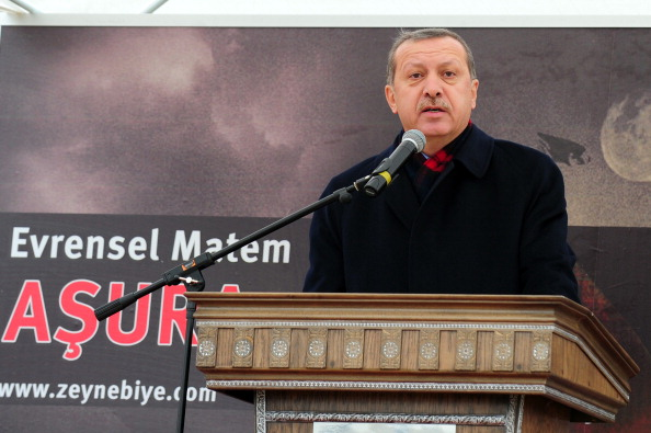 Turkish Prime Minister Recep Tayyip Erdogan speaks to Shiites in Istanbul on December 16, 2010 during Ashura, which commemorates the killing of Imam Hussein, a grandson of the Prophet Mohammed, by armies of the caliph Yazid in 680 AD. Tradition holds that the revered imam was decapitated and his body mutilated in the Battle of Karbala.   AFP PHOTO/MUSTAFA OZER (Photo credit should read MUSTAFA OZER/AFP/Getty Images)