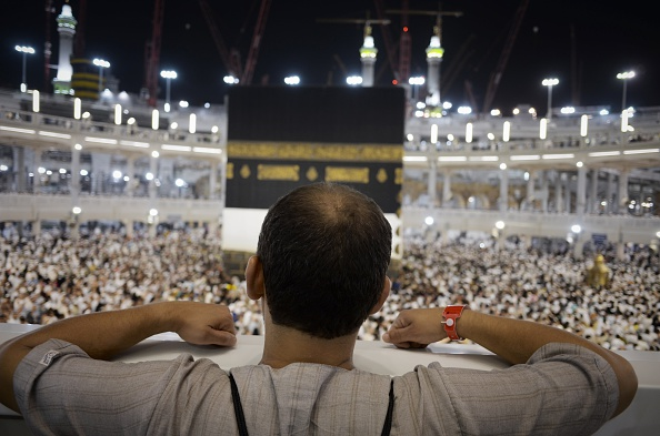 A Muslim pilgrim looks at Islam's holiest shrine, the Kaaba, at the Grand Mosque in the Saudi holy city of Mecca, late on September 20, 2015. The annual hajj pilgrimage begins on September 22, and more than a million faithful have already flocked to Saudi Arabia in preparation for what will for many be the highlight of their spiritual lives. AFP PHOTO / MOHAMMED AL-SHAIKH        (Photo credit should read MOHAMMED AL-SHAIKH/AFP/Getty Images)