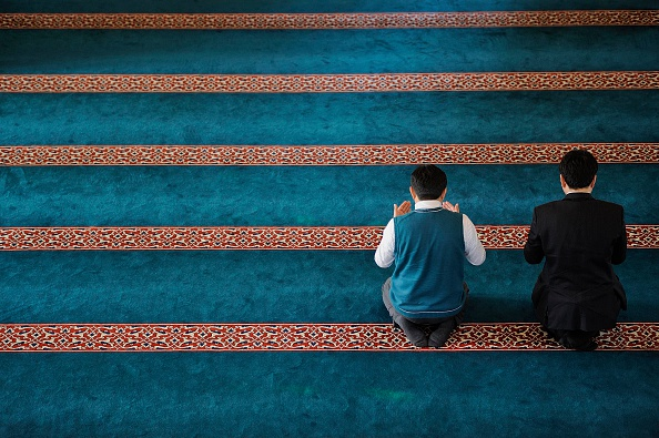 TOKYO, JAPAN - JANUARY 25:  People pray at Tokyo Mosque on January 25, 2015. Tokyo Mosque which is open to public during the five daily prayers, attacts people's attention who want to discover Islam, or simply admire the architecture of the religious edifice. (Photo by David Mareuil/Anadolu Agency/Getty Images)