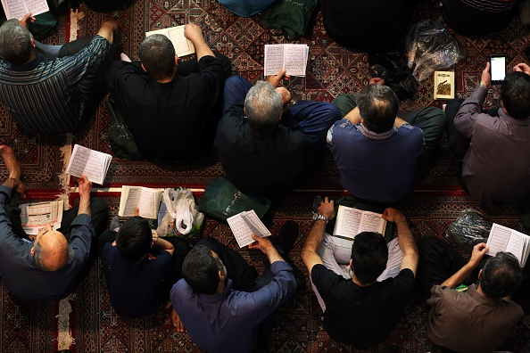 Iranian Shiite Muslims pray in Tehran in the early hours of July 7, 2015 in commemoration of the death of the seventh century Imam Ali bin Abi Taleb and in preparation for Laylat al-Qadr -- a high point during Ramadan when the Koran holy book was revealed to the Prophet Mohammed. Imam Ali, the first male convert to Islam, is the fourth caliph to succeed Prophet Mohammed, his cousin and father-in-law. AFP PHOTO/ATTA KENARE        (Photo credit should read ATTA KENARE/AFP/Getty Images)