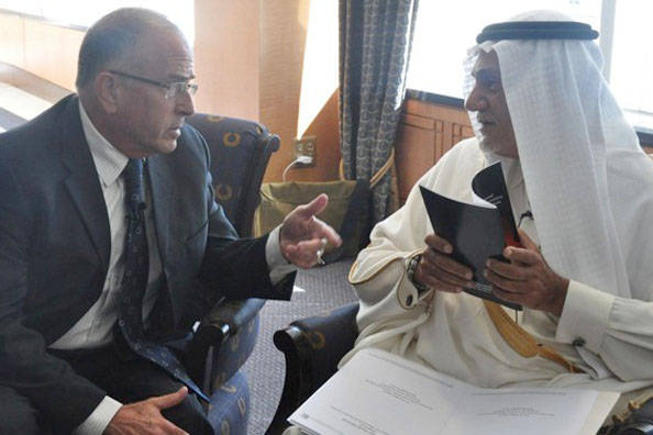 Former Saudi ambassador Prince Turki bin Faisal al-Saud confers with Israeli strategic affairs analyst Yossi Alpher at the National Iranian American Council conference in Washington, Oct. 15, 2013.