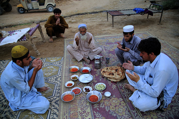 ISLAMABAD, PAKISTAN - JUNE 19 :  Afghan refugees break their fast at a refugee camp in Islamabad, Pakistan on June 19, 2015. (Photo by Metin Aktas/Anadolu Agency/Getty Images)